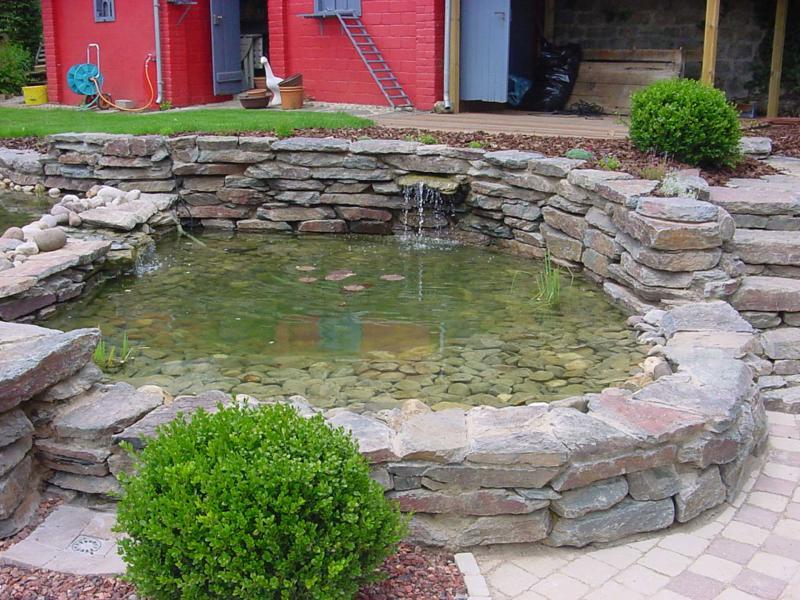 Gestaltung Gartenteich naturstein wolf gartenteichgestaltung mit naturstein und findlingen
